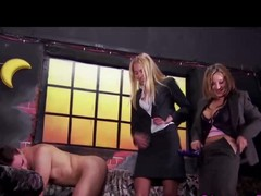 Dominatrixes using strapon in guy
