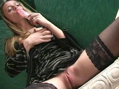 Cute honey takes off clothing and stimulates clitoris by vibrator