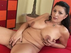 Mature Grace playing with stiff cock