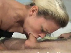 Blonde spread out gives deepthroat blowjob in a assembly room