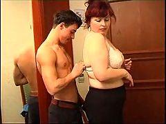 Redhead mom enjoys sex with lad