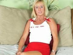 Skinny mature blonde adjacent to blue eyes strips nude